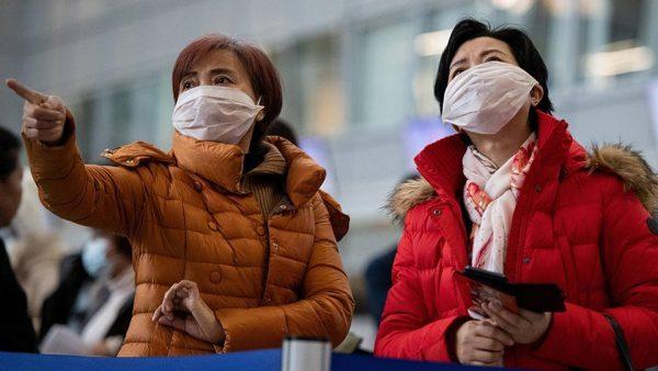 КНР: заражение коронавирусом может произойти с расстояния двух ...